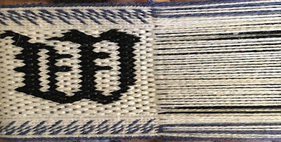 A photo of a section of tablet woven band ready to weave the next section of the draft