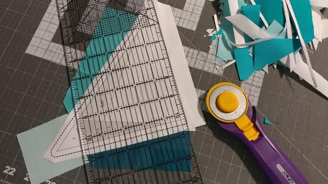Paper piecing the Mariner's Compass block in solid aquas for the QAL By the Sea