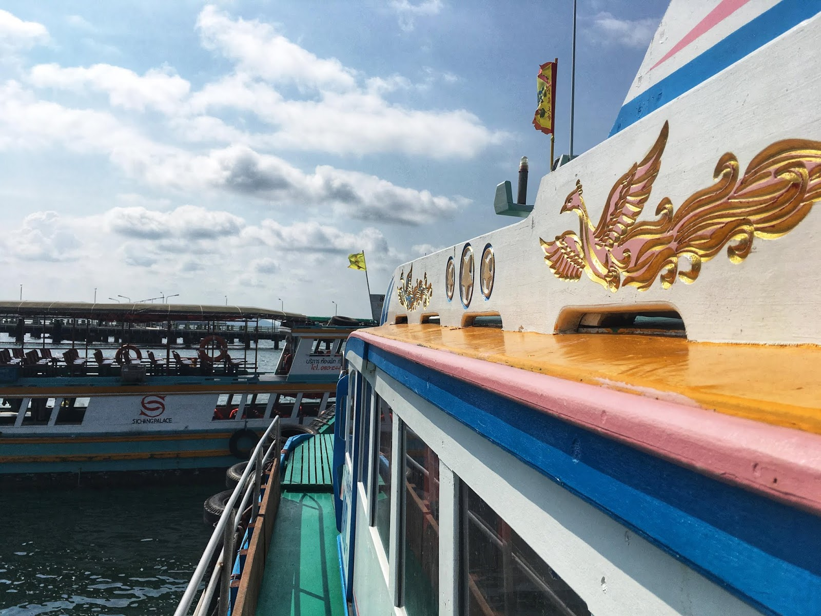 a colorful wooden ferry boat in Thailand