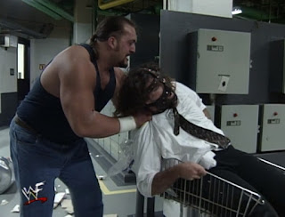 WWE / WWF - Backlash 1999 - The Big Show puts Mankind in a shopping cart in their Boiler Room Brawl