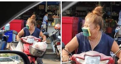 Günstige Corona Gesichtsmaske einer Hausfrau lustig