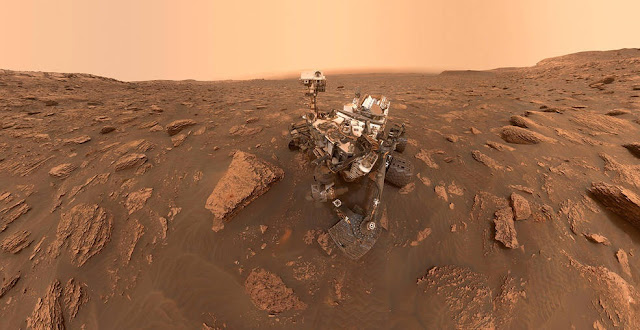A self-portrait of NASA's Curiosity rover taken on Sol 2082 (June 15, 2018). A Martian dust storm has reduced sunlight and visibility at the rover's location in Gale Crater. Credits: NASA/JPL-Caltech