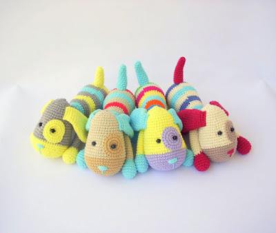 Four Colorful crochet amigurumi dogs with eye patch