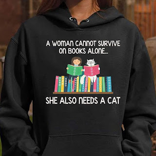 A woman cannot survive on books alone, she also needs a cat