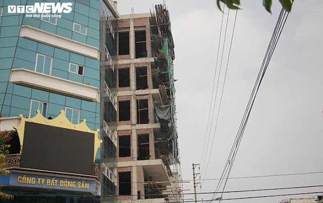 Đường 'Nhuệ' mua cả chính quyền thành phố?: Hai tòa nhà vi phạm trật tự xây dựng, vẫn đứng sừng sững