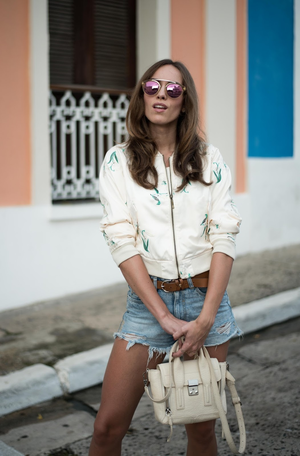 white bomber jacket denim shorts summer outfit