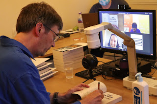 Ian Rankin signing books on a zoom call