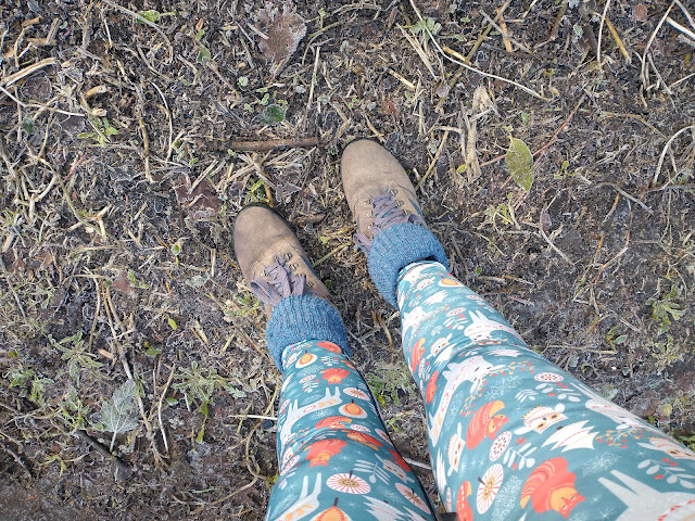 Cheerful leggings, walking boots and mud