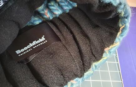 close up inside view of Vegan Happy Beechfield pompom hat showing soft fabric rim