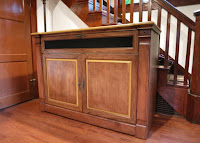 Adonzo Unfinished TV Lift Cabinet stained in American Walnut.