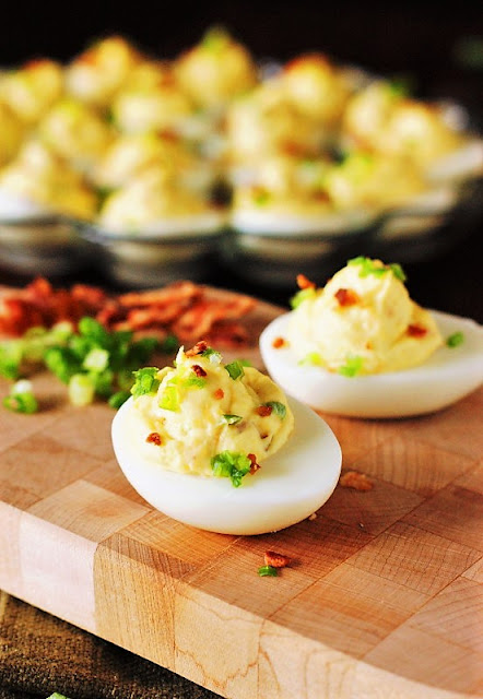 Bacon-Cheddar Deviled Eggs Image ~ Shake up those traditional flavors by serving up a platter of Bacon-Cheddar Deviled Eggs.  They're a true bite of bacon-cheddar deliciousness!