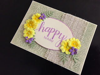 Birthday card with wax resist background primroses and violets