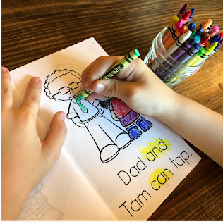 Kid is coloring images inside of the decodable reader.