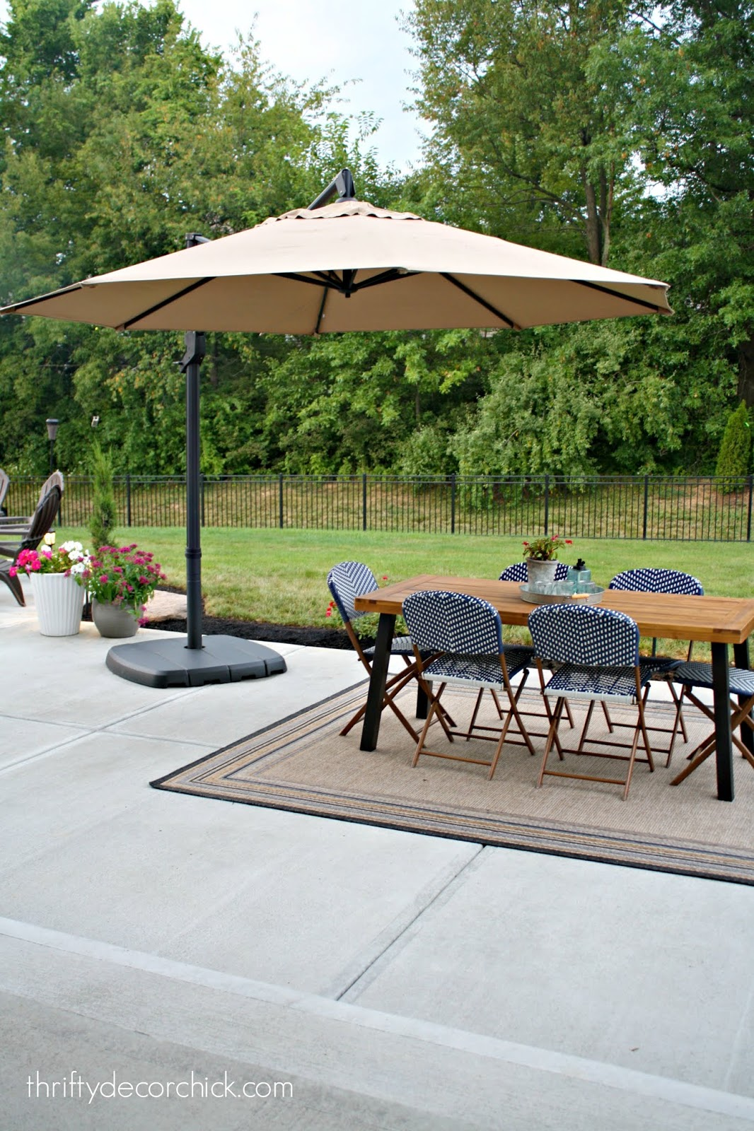 Large arching umbrella on patio