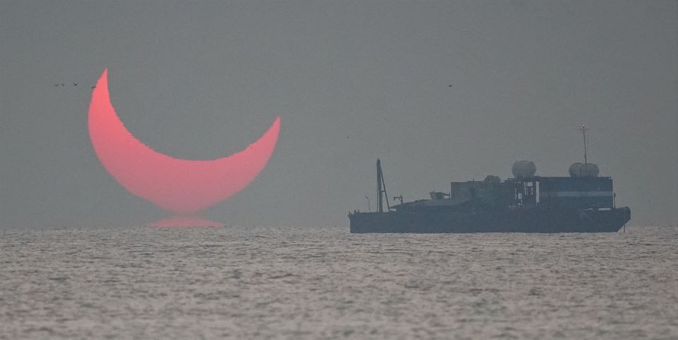 The Sun Looks Like The Devil as Man Photographs Solar Eclipse In Qatar