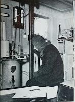 An Endurance crew member observing a scientific experiment instrument.