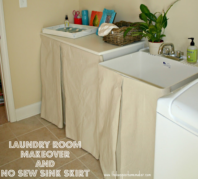 A laundry room with no sew canvas drop cloth skirts covering a sink and shelves