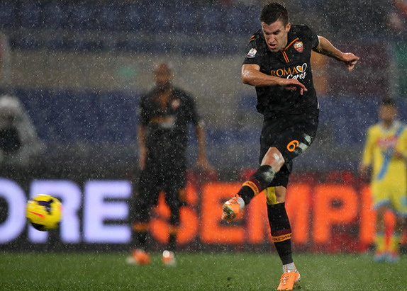 AS Roma player Kevin Strootman shoots to score his team's second goal against Napoli