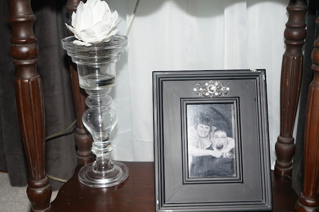 Glass candlestick on antique table