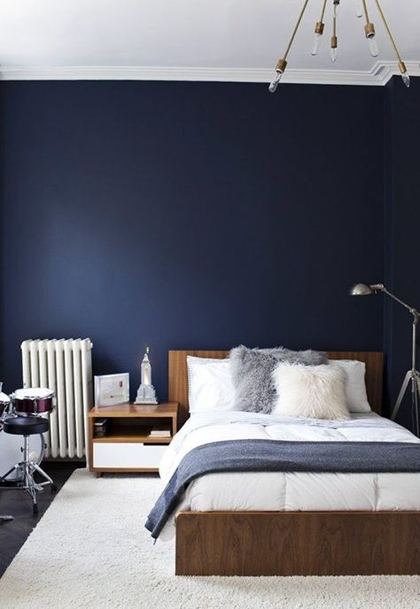 Spectacular The key is to mix different textures like sumptuous linen and natural leather with dramatic blue walls for a sophisticated and intimate space