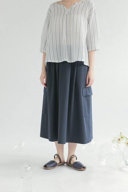 深藍色彈力大口袋過膝裙