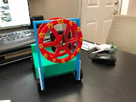 Attach the Clock Wheel to the mast of the Forklift