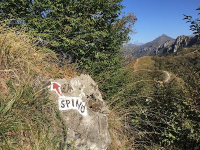 Rock with painted trail indication at Pizzo di Spino.