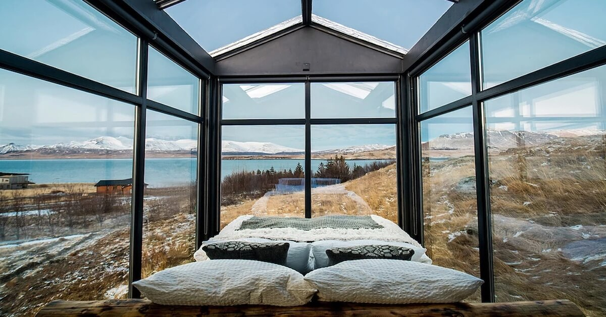 Cabin With Glass Walls In Iceland Lets Visitors Gaze At The Northern Lights While Lyiing In Their Bed