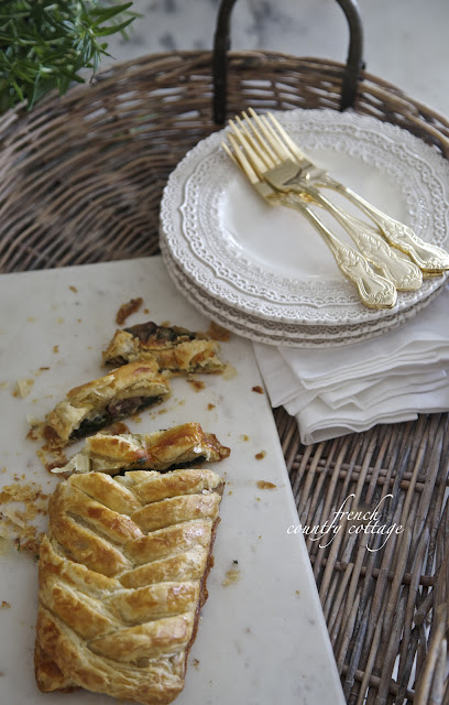 Spinach mushroom pastry braid on marble board in basket