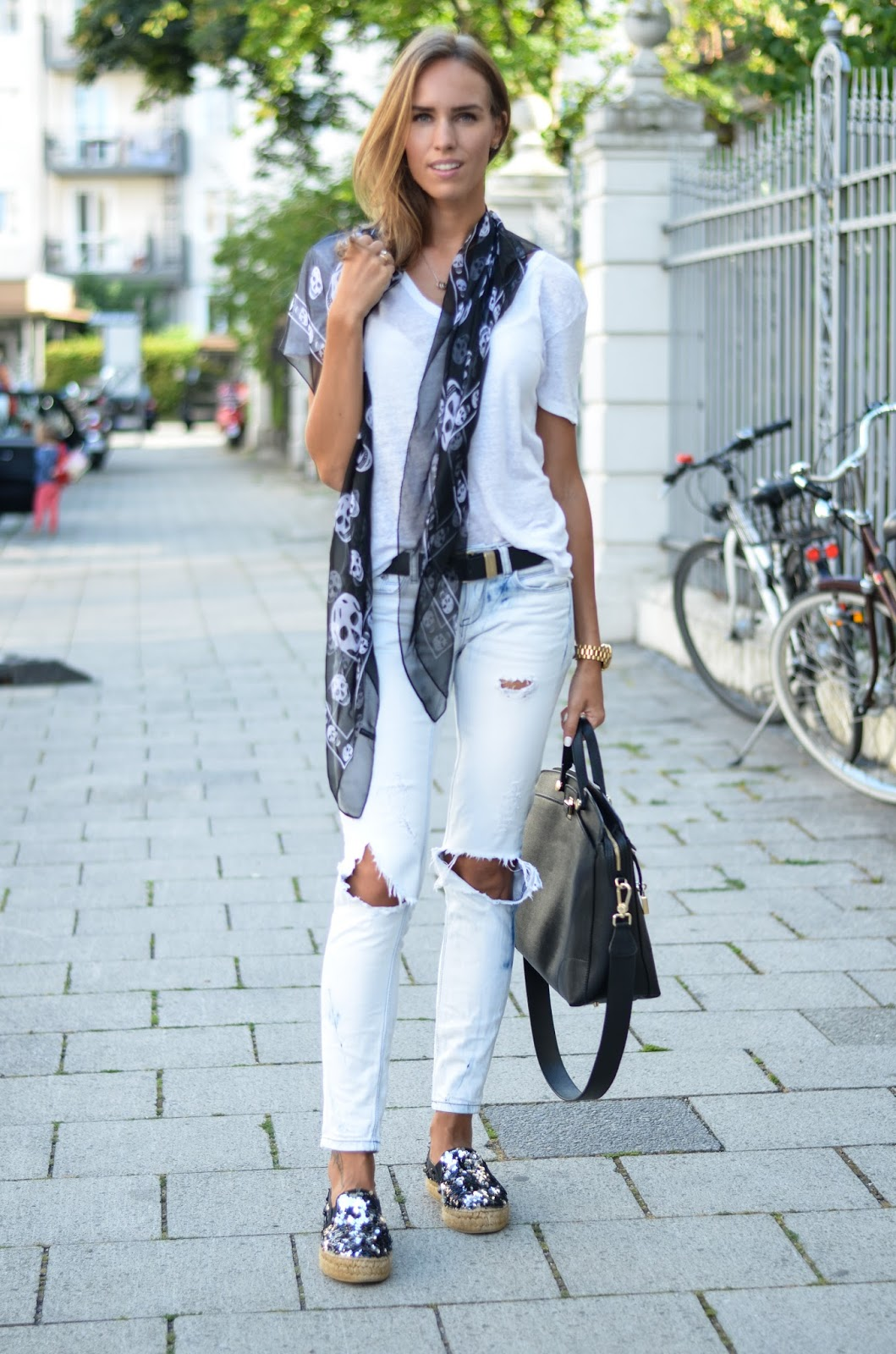 kristjaana mere white ripped jeans black mcqueen scarf