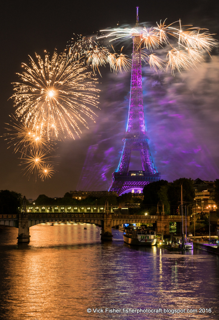 Tour Eiffel Tower fireworks Paris France July 14th Bastille Day Seine river reflection spectacle spectacular amazing public night light transcendent sublime stunning dazzling lighting beautiful colorful celebrate celebration fete festival summer Juillet feu d'artifice travel tourism vacation