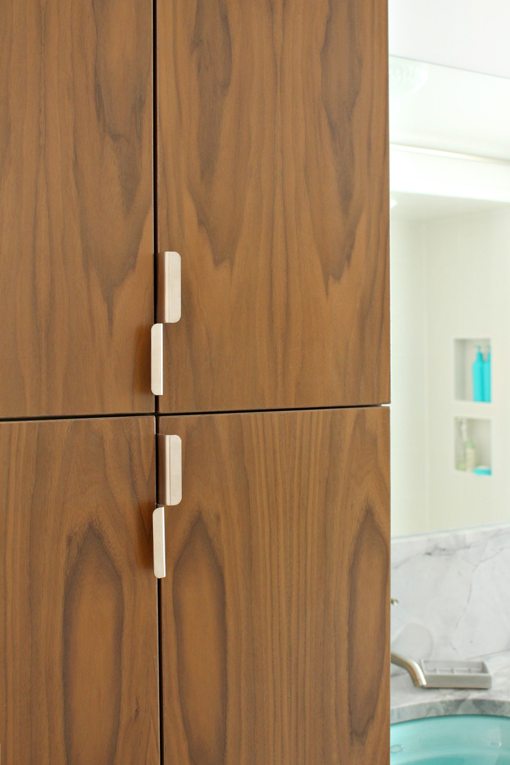 Vertical pulls on tall cabinet doors