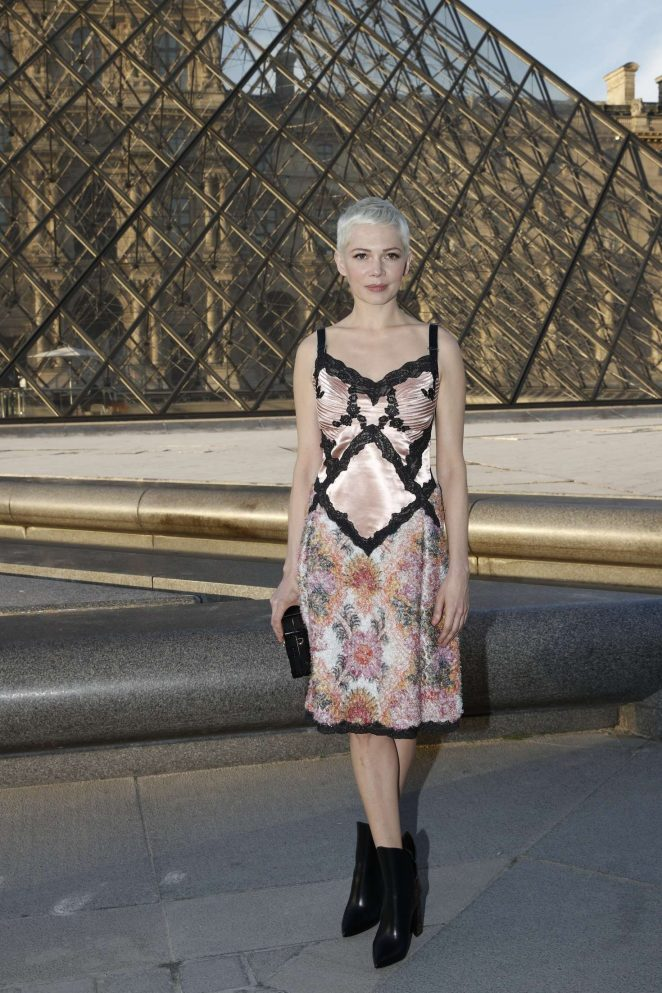 Michelle Williams wears unusual lacy dress to the Louis Vuitton launch in Paris