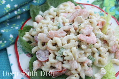 Shrimp and Macaroni Salad from Deep South Dish blog. A macaroni salad made with shrimp, celery and green onion, and dressed with a blend of seasoned mayonnaise and sour cream. Sliced grape tomatoes are tossed in just before serving.
