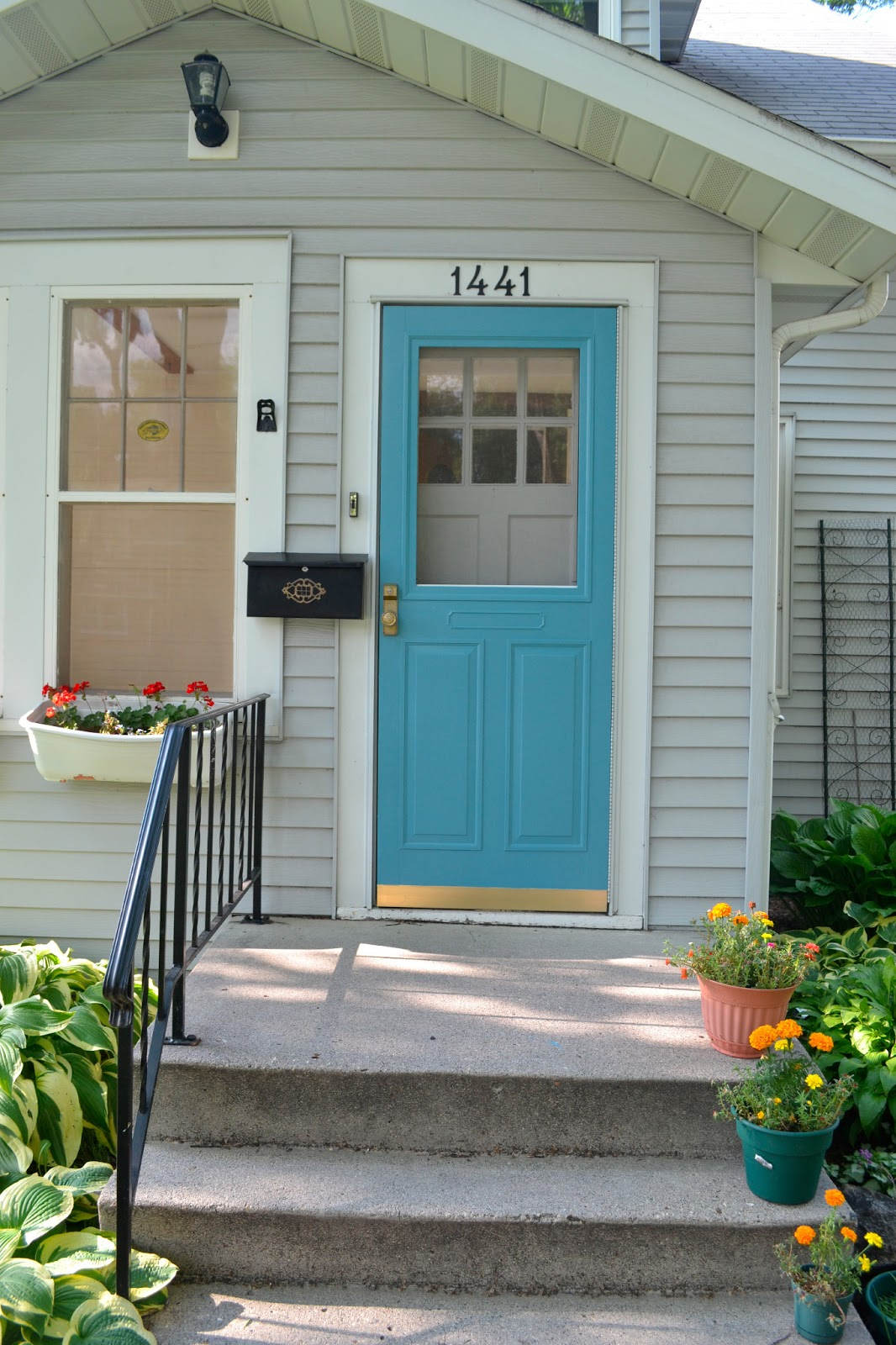 Our house in the middle of our street a colorful entrance - Door colors for gray house ...