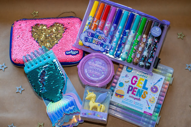 Smiggle gift suggestions for Tweens: Unicorn Universe scented markers and eraser, Unicorn Fluffy Sand, Scented gel pens, mermaid notepad and a pencil case with reversible sequins on