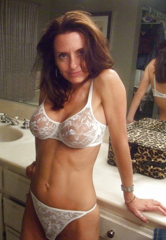 Housewife wearing white lace bra and panties