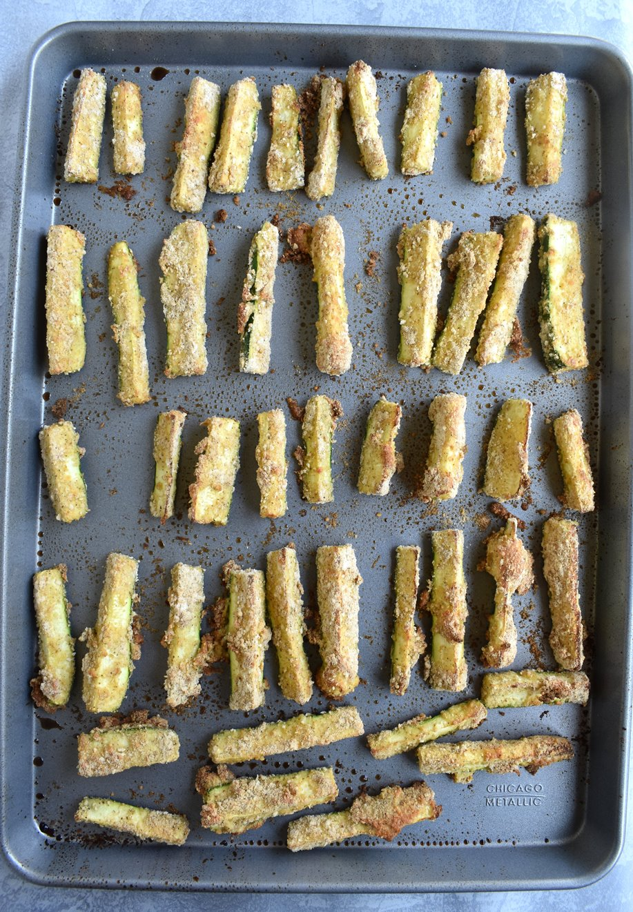 Breaded Zucchini Fries with Creamy Dijon Dipping Sauce are baked and super crispy, coated in a Parmesan garlic breading that can be enjoyed as an appetizer or side dish! #zucchini #fries #appetizer #dijon #vegetarian #healthy #cleaneating