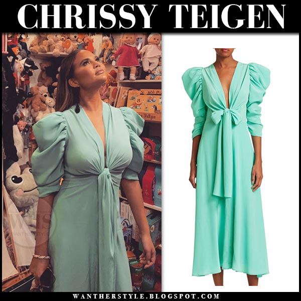Chrissy Teigen in aqua green puff sleeve bow dress silvia tcherassi. Celebrity spring summer style