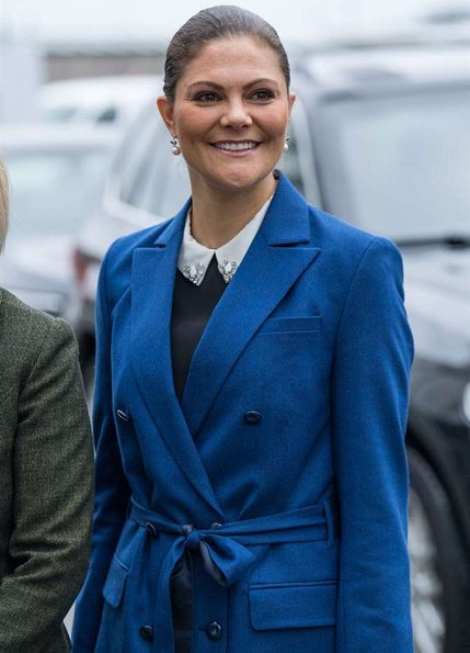 Crown Princess Victoria wore Af Klingberg Rakel Suede Nero Boots, Dagmar Taylor Tote Bag. Blue wool coat