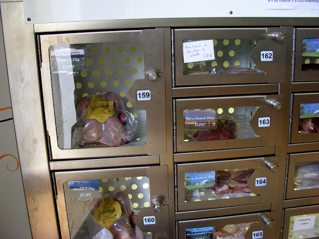 Self-service poultry vending machine.  Indre et Loire, France. Photographed by Susan Walter. Tour the Loire Valley with a classic car and a private guide.