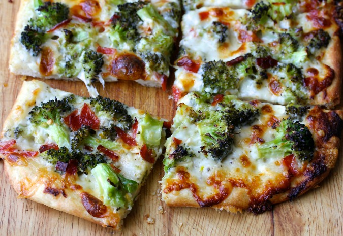 The crust on this broccoli pizza is really thin and incredibly crisp, and the combination of the cheeses,  a garlicky white sauce, and the roasted broccoli is wonderfully flavorful. Yes, broccoli pizza is seriously and unexpectedly tasty.