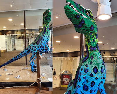 Huge 9ft LEGO dinosaur velociraptor model inside coffee shop window