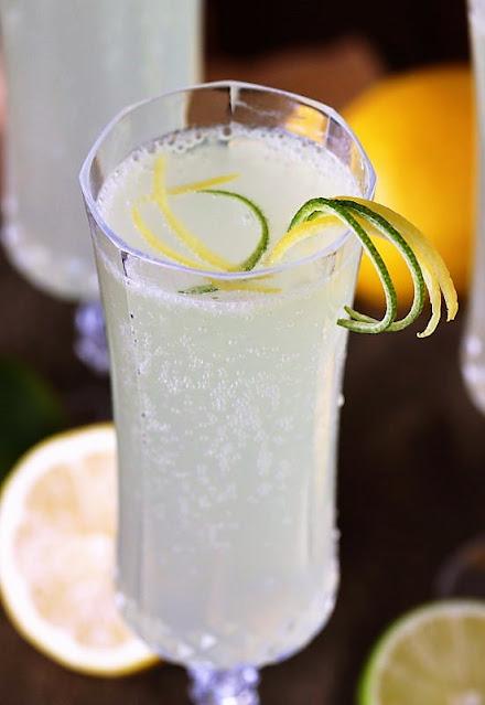 Sparkling Limoncello Cooler Garnished with Lemon & Lime Zest Image
