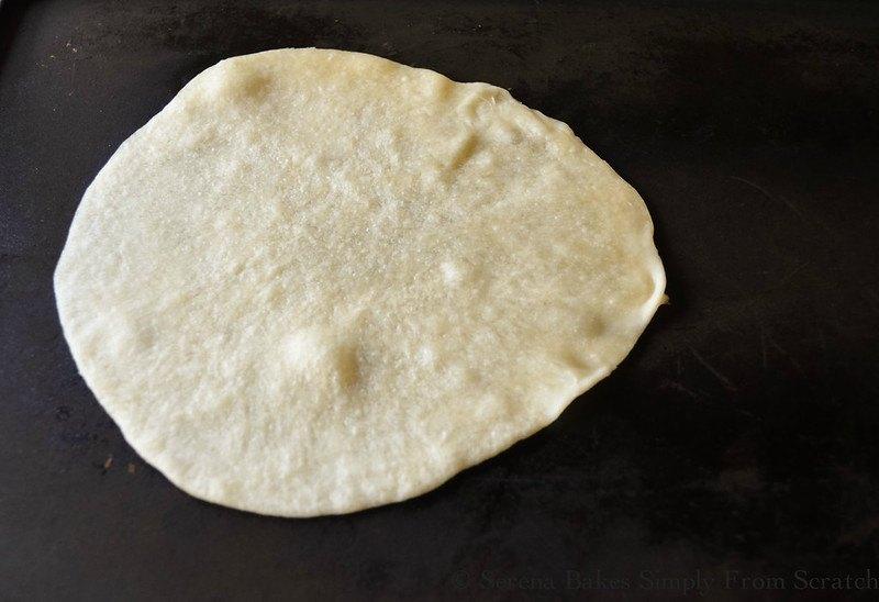 Homemade Flour Tortilla cooking on a cast iron pan.