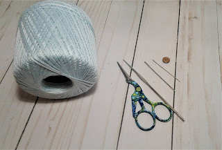 materials cotton thread, crochet hook, needle, yarn needle and scissors