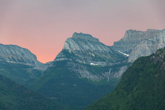 Sunrise looking towards Logan Pass, the Garden Wall, and Bird Woman Falls