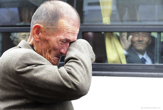North Korean waves at his South Korean brother after inter-Korean temporary family reunions in 2010