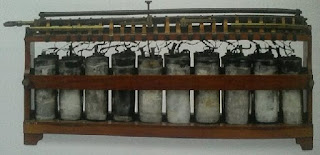 early battery array with 10 cylinders in wooden frame