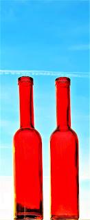 Agua solarizada botella roja